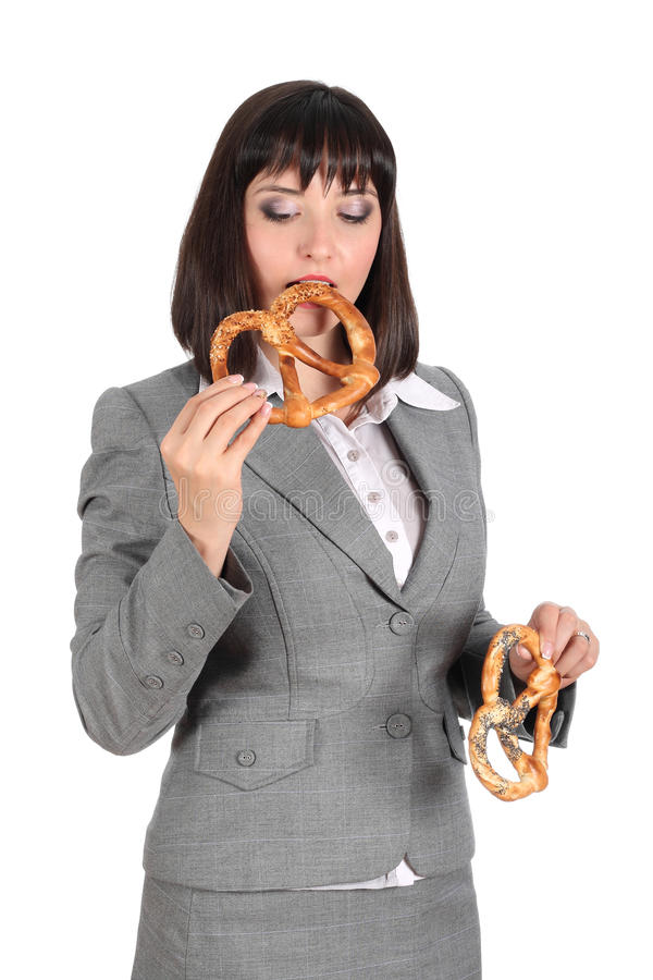 Download Young Woman Eating A Pretzel Stock Image - Image: 17036617