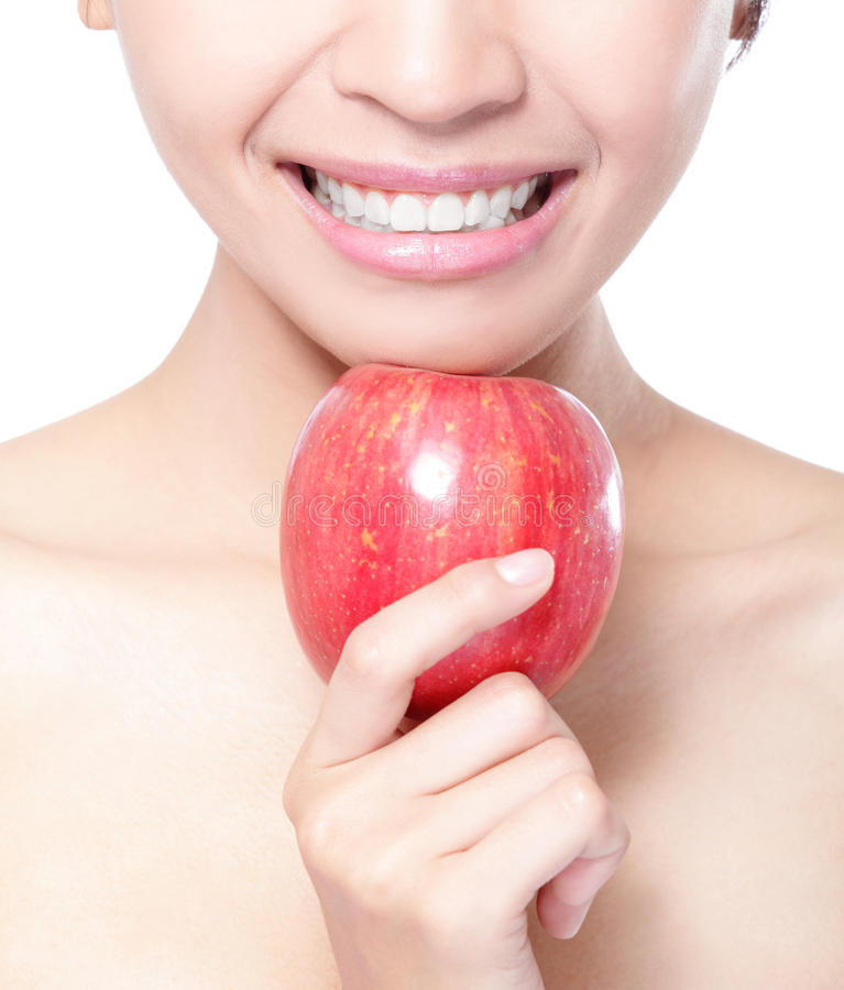 Young woman eating red apple with health teeth. Beautiful young woman eating red apple with health teeth. Isolated over white background, asian beauty model stock images