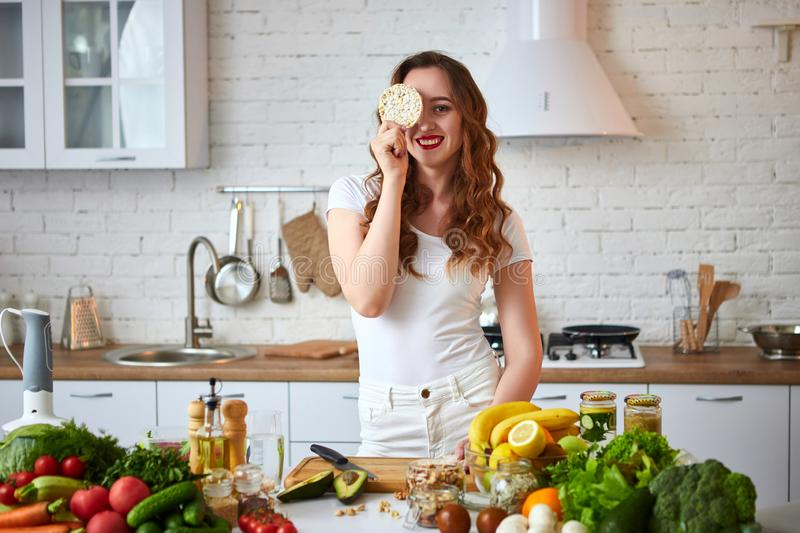 Young woman eating rye cracker crisp bread in the kitchen. Healthy Lifestyle. Health, Beauty, Diet Concept. Young woman eating rye cracker crisp bread in the royalty free stock images