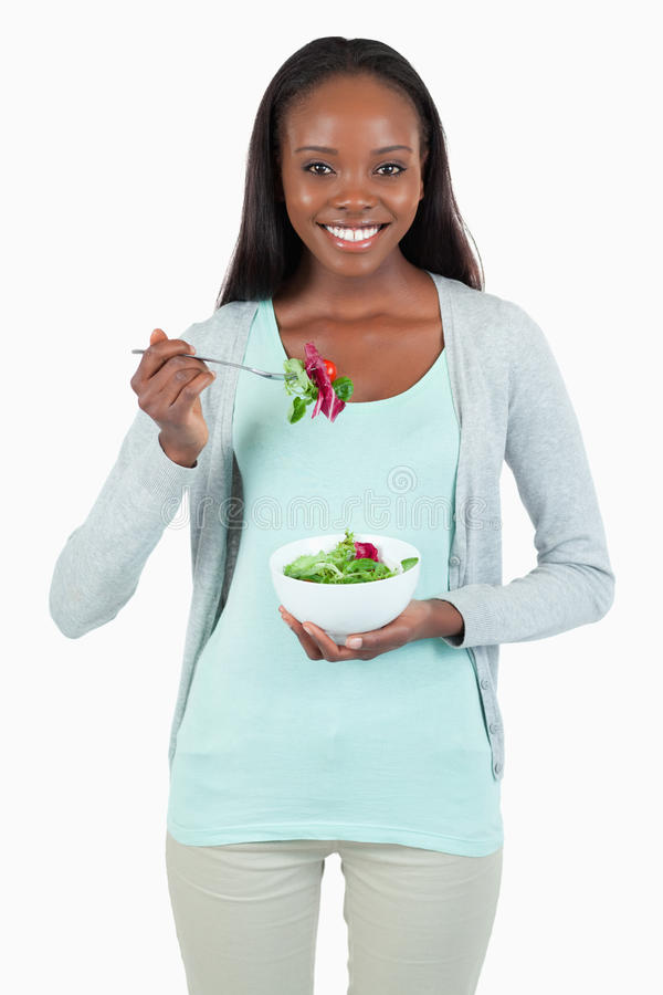 Download Young woman eating salad stock photo. Image of diet, lifestyle - 22046810