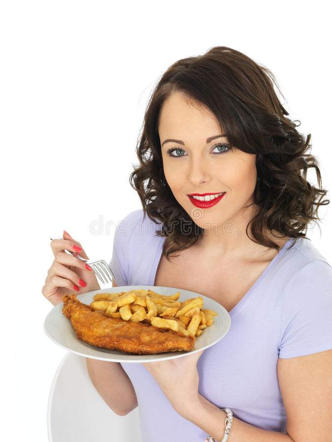Young Woman Eating Traditional Fish and Chips. Young Attractive Woman Eating Traditional Fish and Chips stock photos