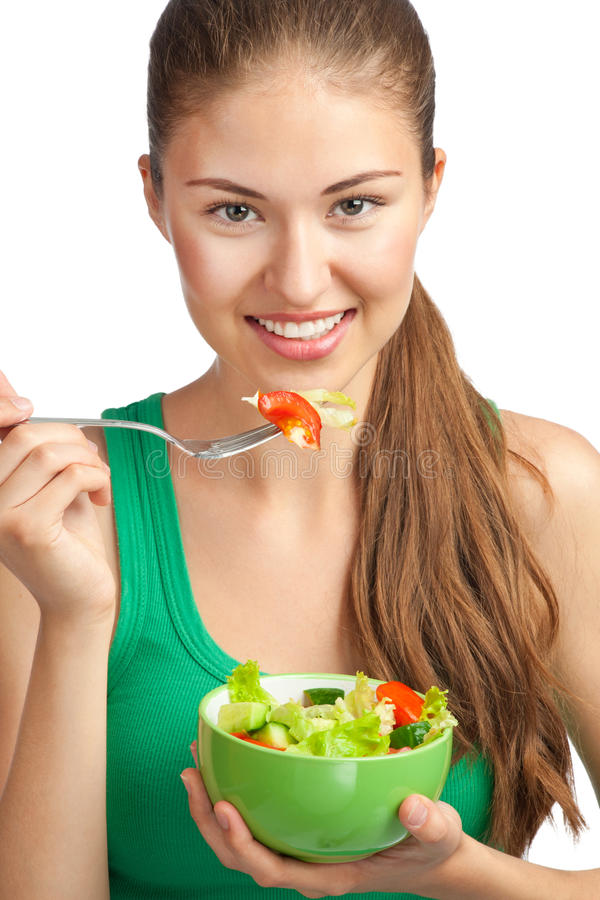 Young Woman Eating Vegetable Salad Royalty Free Stock Image
