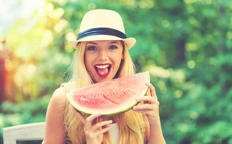 Young woman eating watermelon outside royalty free stock image