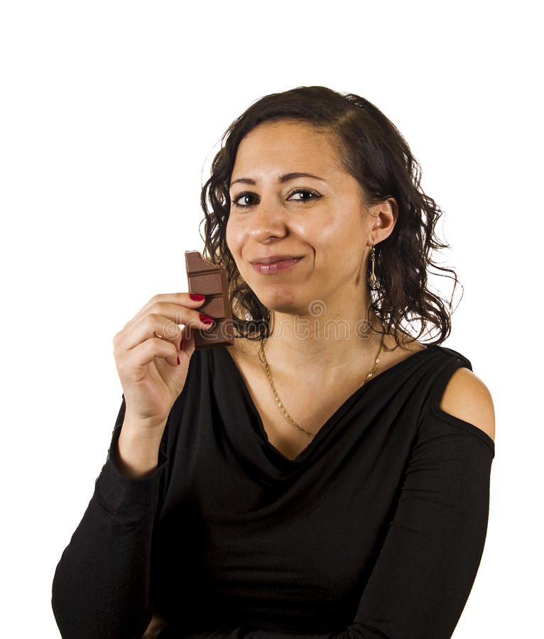 Young Woman Eats Chocolate royalty free stock images