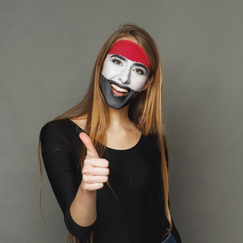 Young woman with Egypt flag painted on her face stock images