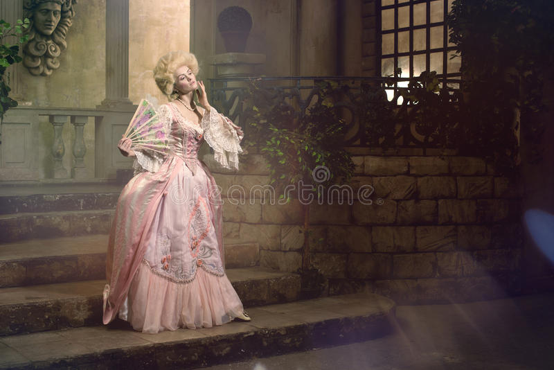 Young woman in eighteenth century image posing in vintage exterior stock photos