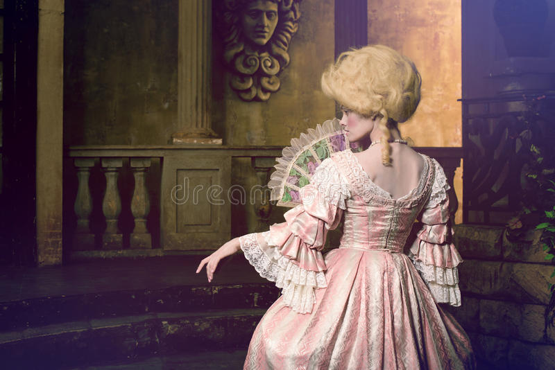 Young woman in eighteenth century image posing in vintage exterior royalty free stock photography
