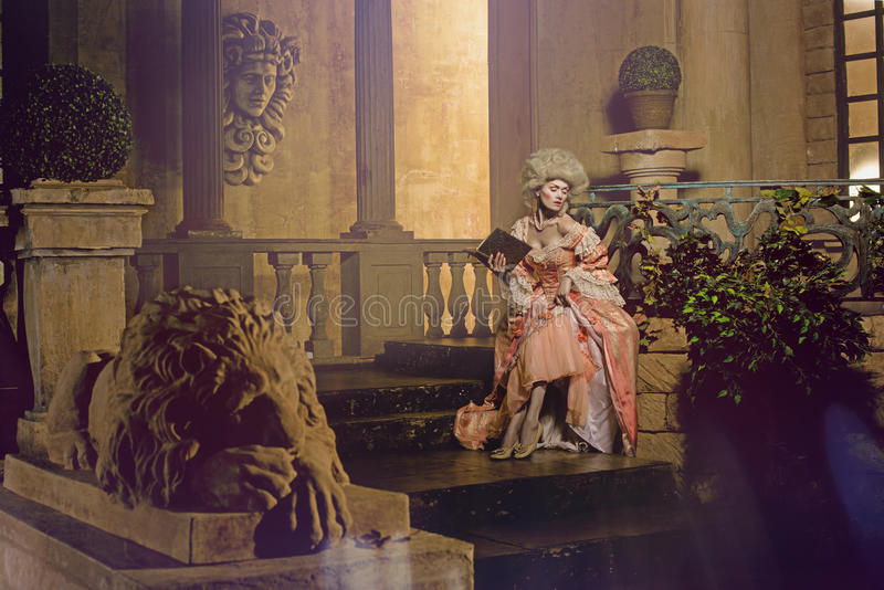 Young woman in eighteenth century image posing in vintage exterior stock photo