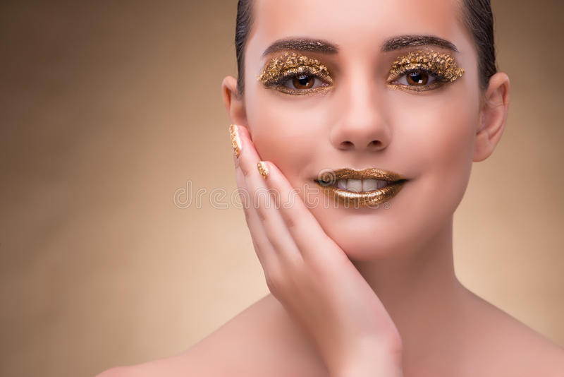 The young woman with elegant makeup. Young woman with elegant makeup stock photos