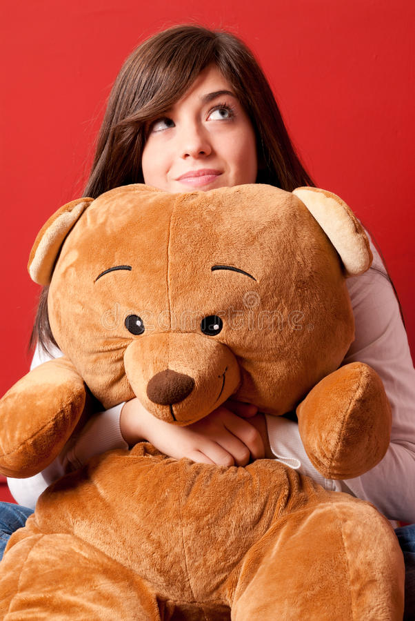 Download Young Woman Embracing Teddy Bear Looking Up Stock Photo - Image of closeup, love: 23954976