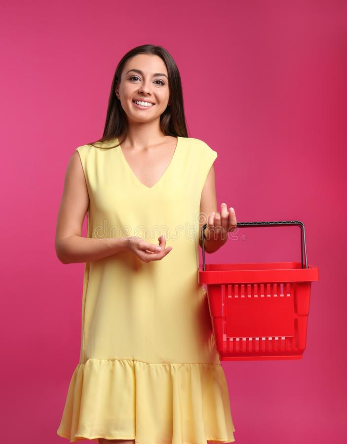 Young woman with empty shopping basket royalty free stock image