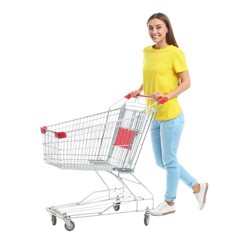 Young woman with empty shopping cart on background. Young woman with empty shopping cart on white background stock photos