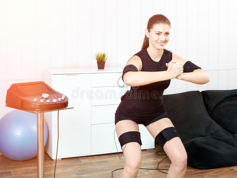 Young woman in an EMS workout. stock photos