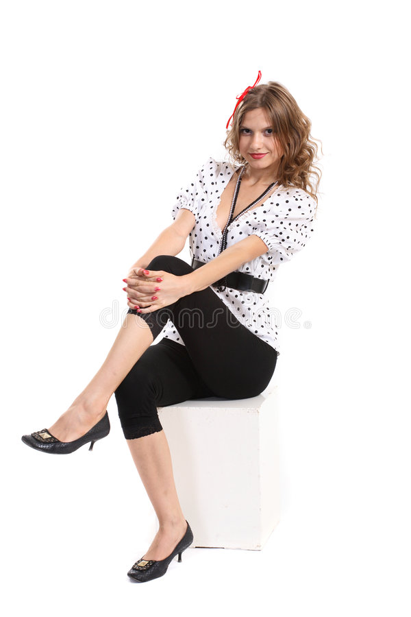 Young woman end white cube. stock images