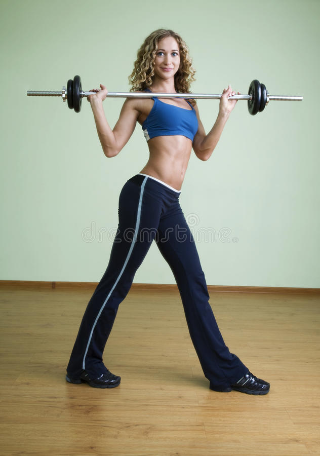 Download A Young Woman Is Engaged In Weightlifting Stock Image - Image: 13133269