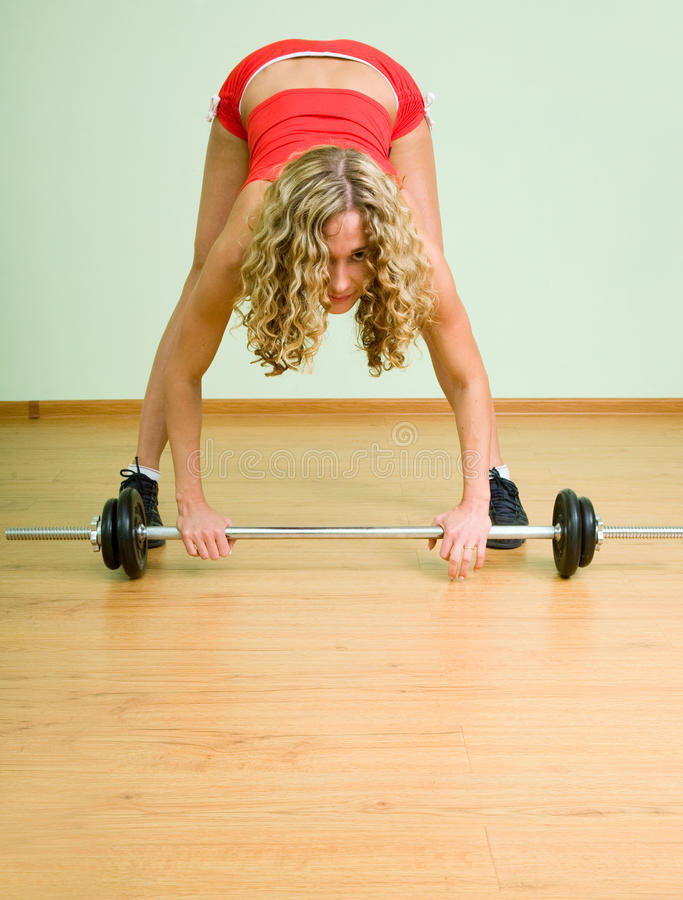 Download A Young Woman Is Engaged In Weightlifting Stock Photo - Image: 15737978
