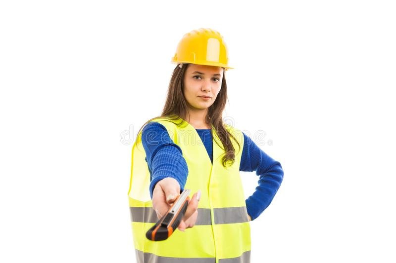 Young woman engineer handing cutter royalty free stock image