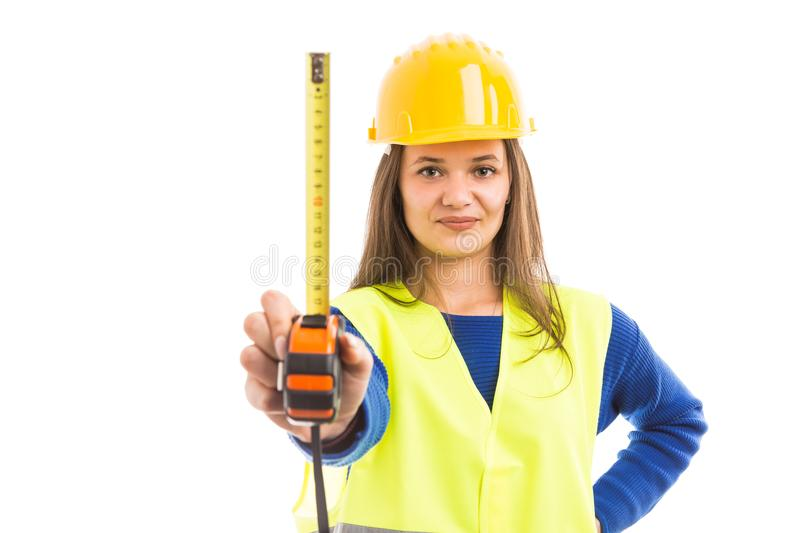 Young woman engineer holding measuring tape royalty free stock photography