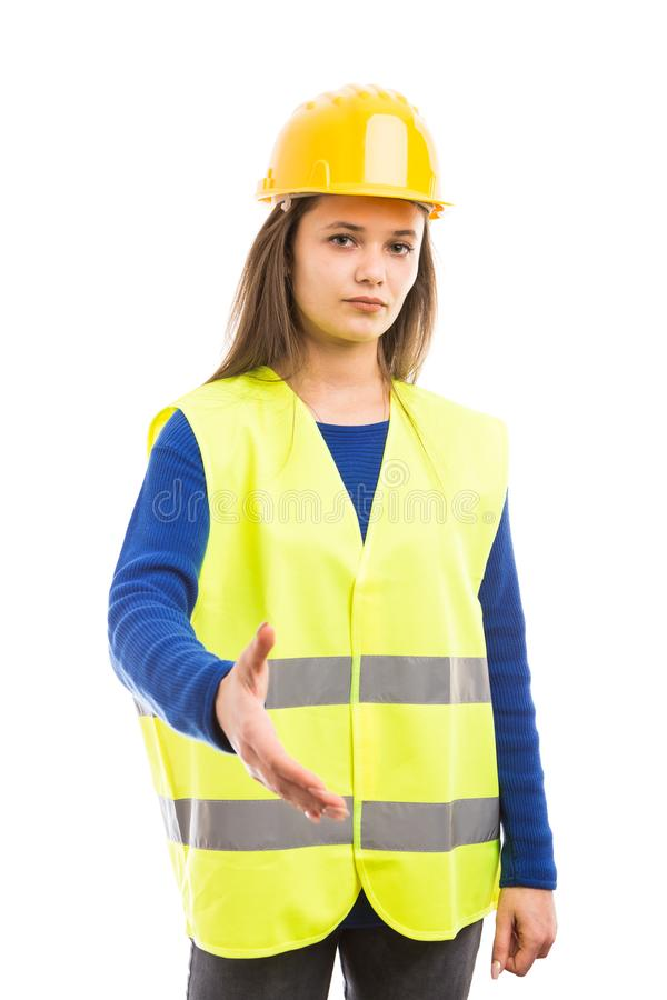 Young woman engineer offering handshake royalty free stock image
