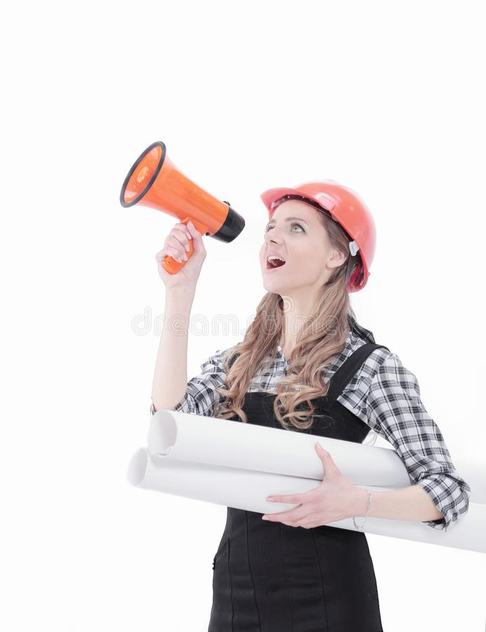 Young woman engineer shouting into a megaphone royalty free stock photo