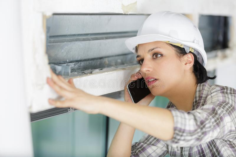 Young woman engineer talking on mobile phone stock images