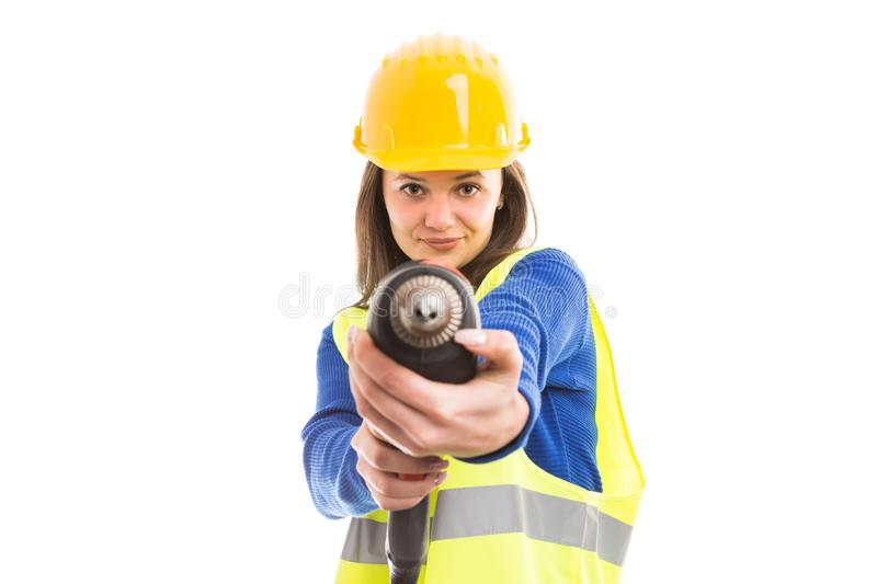 Young woman engineer using drilling machine stock image