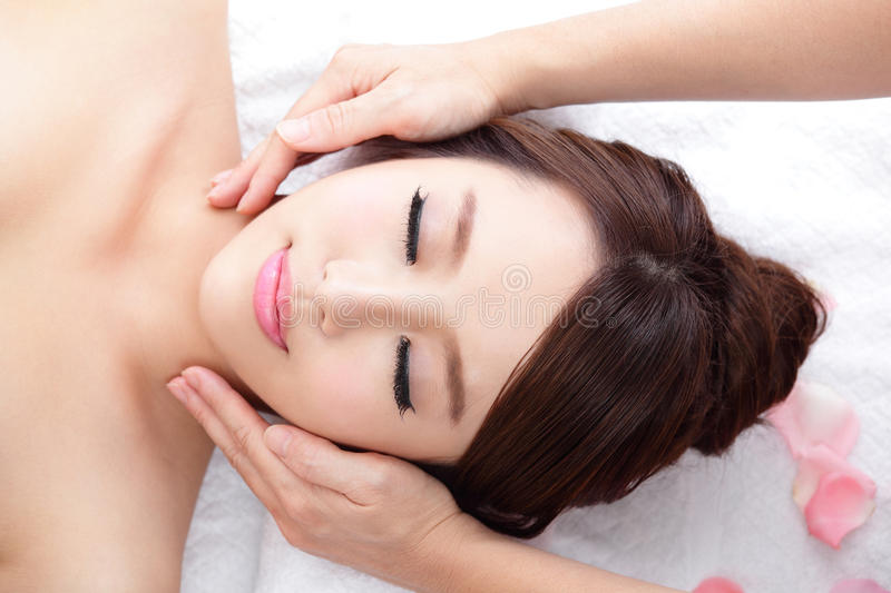 Young woman enjoy massage at spa stock photography