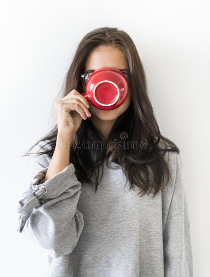 A young woman enjoy morning hot coffee drink stock photo