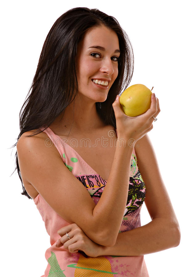 Young woman enjoying an apple royalty free stock photos