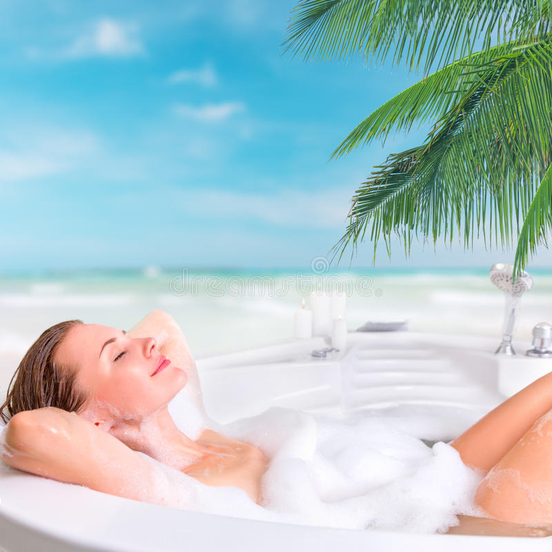 Young woman enjoying bath in the resort royalty free stock photography