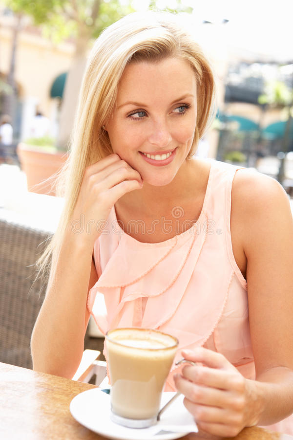 Young Woman Enjoying Cup Of Coffee