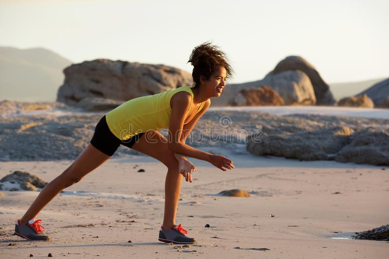Young woman enjoying exercise on the beach royalty free stock photography