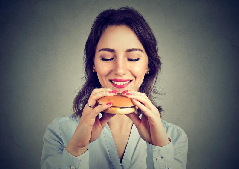 Young woman enjoying fast food stock image