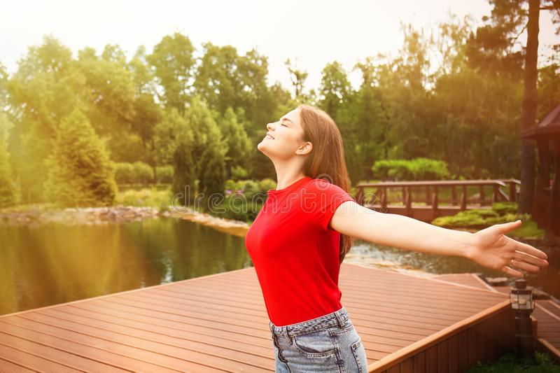 Young woman enjoying the fresh air outdoors stock photography