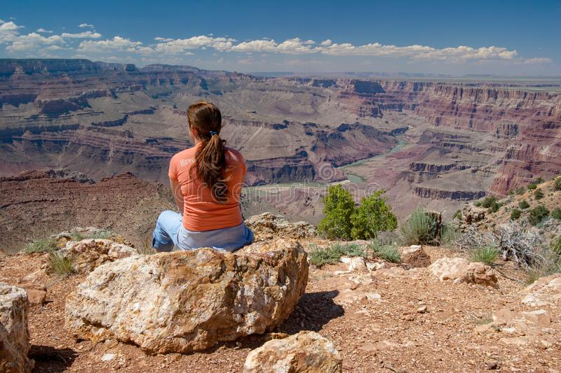 Young woman enjoying Grand Canyon view from Desert View. Young woman enjoys remarkable view of Grand Canyon from Desert View on South Rim, Grand Canyon National stock image