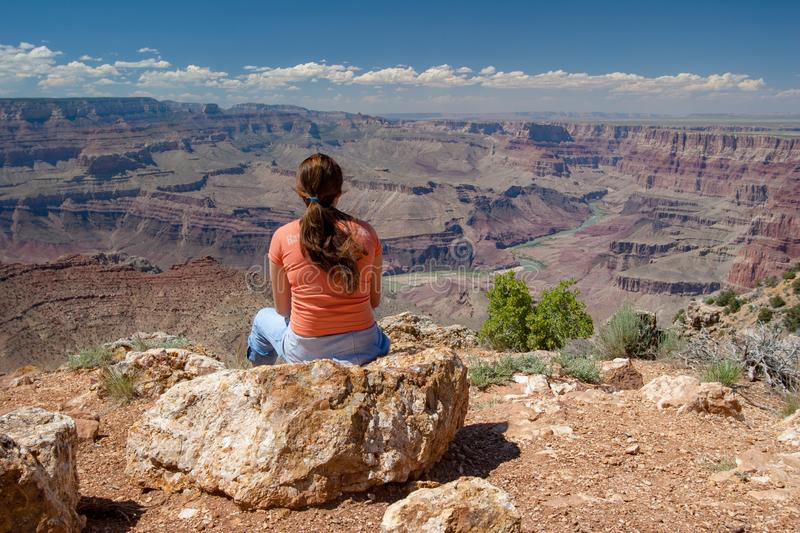 Young woman enjoying Grand Canyon view from Desert View. Young woman enjoys remarkable view of Grand Canyon from Desert View on South Rim, Grand Canyon National royalty free stock image