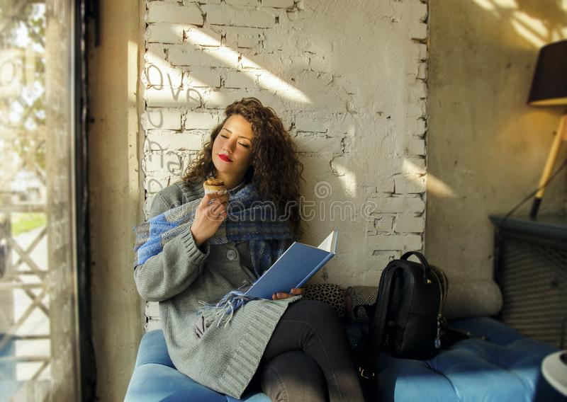 Young woman enjoying her free time in coffee shop royalty free stock photo