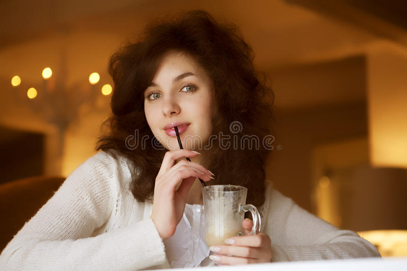 Young Woman Enjoying Latte Coffee In Cafe Royalty Free Stock Photo