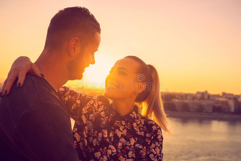 Young woman enjoying in  love at sunset stock photography