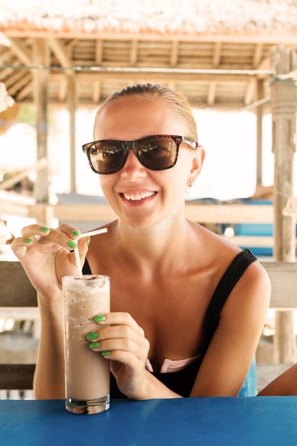 Download Young Woman Enjoying Milkshake Stock Photo - Image of good, outdoor: 31395452