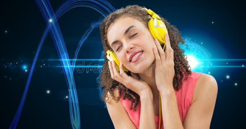 Young woman enjoying music on headphones. Digital composite of Young woman enjoying music on headphones royalty free stock photo
