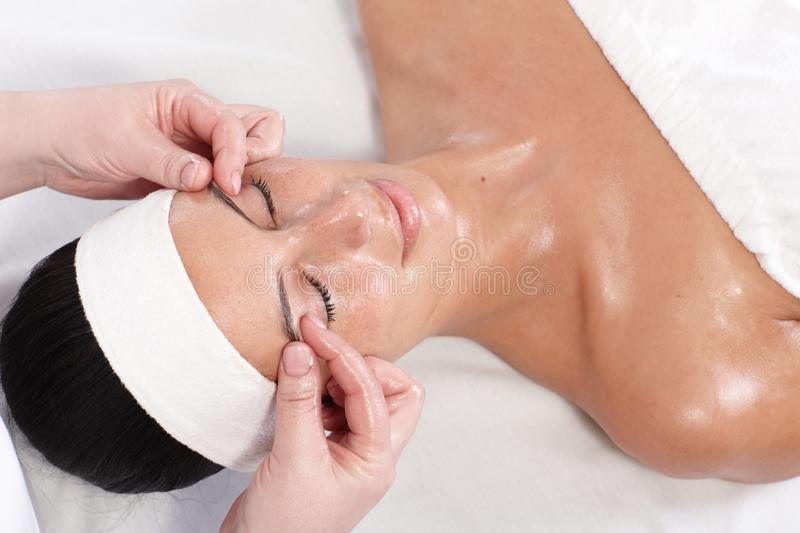 Young Woman Enjoying Pampering In Beauty Saloon Royalty Free Stock Photography