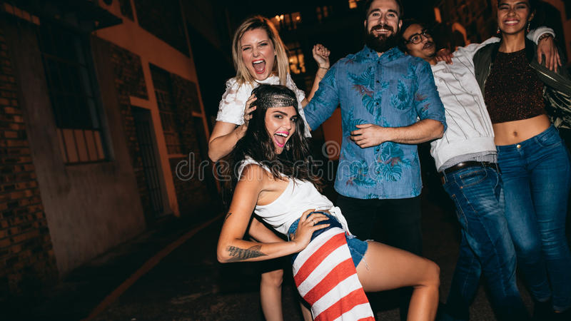Young woman enjoying party with her friends stock image