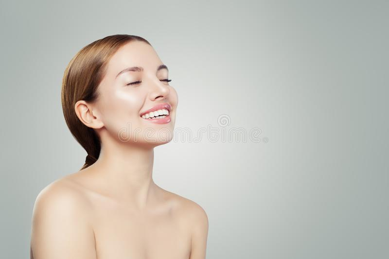 Young woman enjoying and relaxing on white background. Cheerful girl portrait.  stock photos