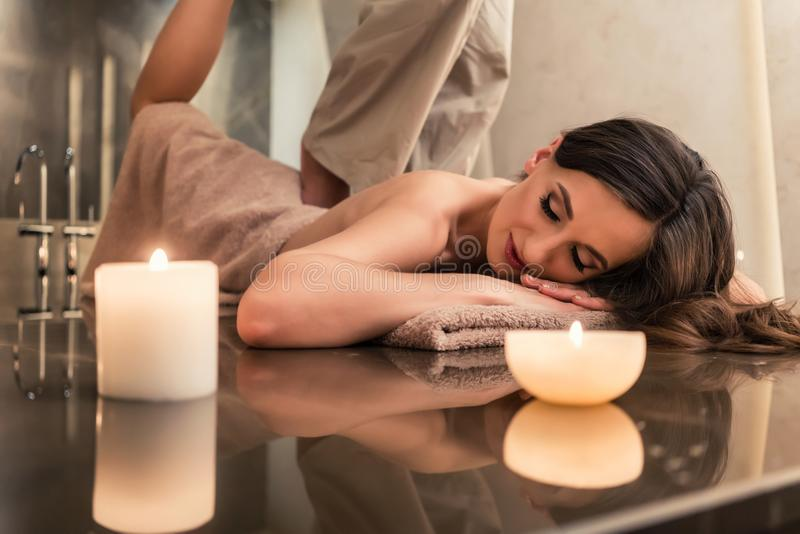 Young woman enjoying the stretching techniques of Thai massage royalty free stock photo