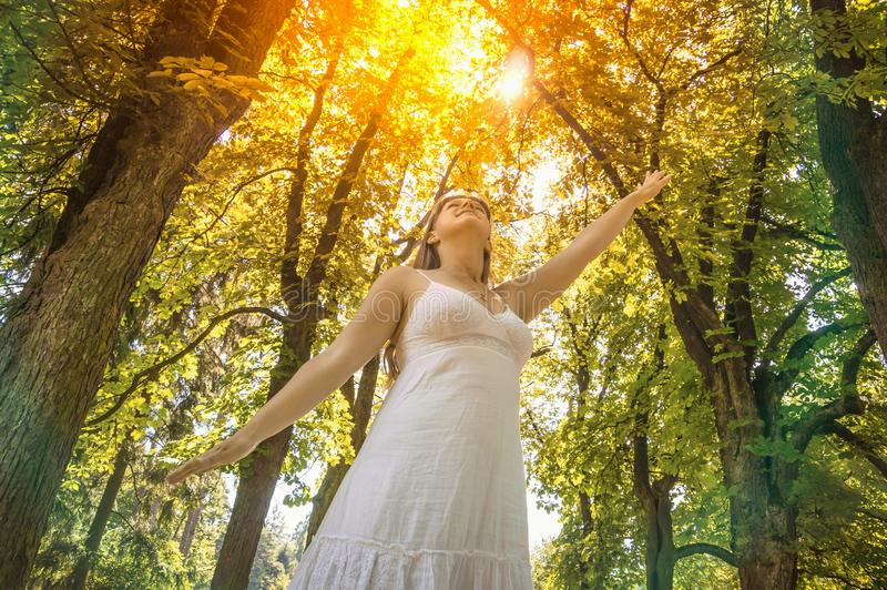 Young woman enjoying the sunshine on a sunny day stock photos