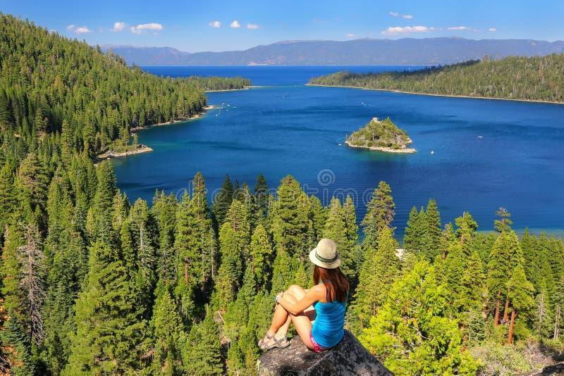 Young woman enjoying the view of Emerald Bay at Lake Tahoe, Cali stock photo