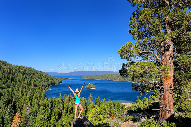 Young woman enjoying the view of Emerald Bay at Lake Tahoe, Cali. Fornia, USA. Lake Tahoe is the largest alpine lake in North America royalty free stock image
