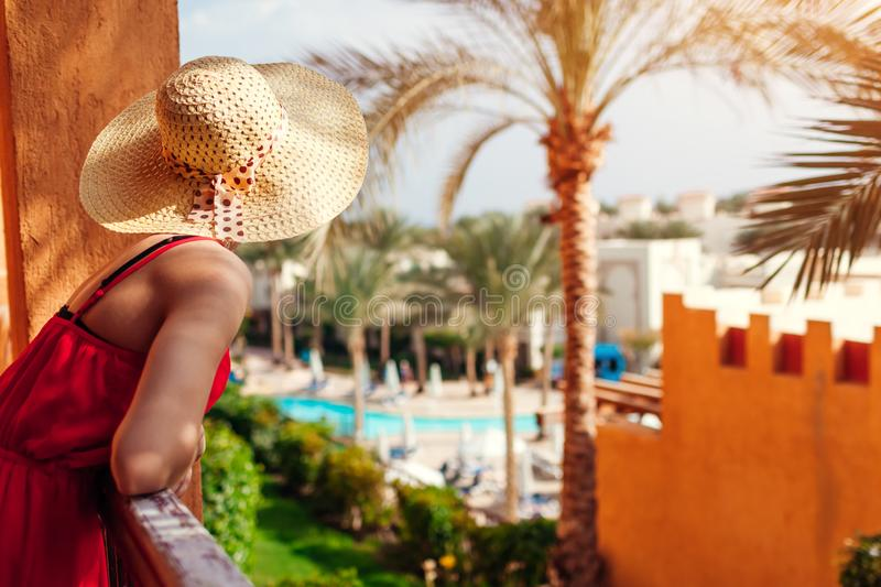 Young woman enjoying the view from hotel balcony in Egypt. Having good time in tropical resort stock image