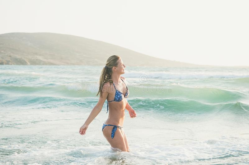 Young woman enjoying warm waters of Mediterranean sea, Greece royalty free stock images